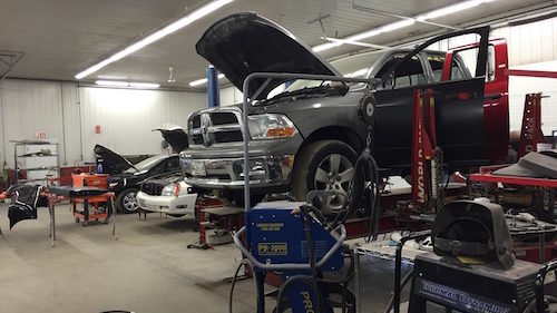 Hilltop Collision Inside Shop with Truck on Lift